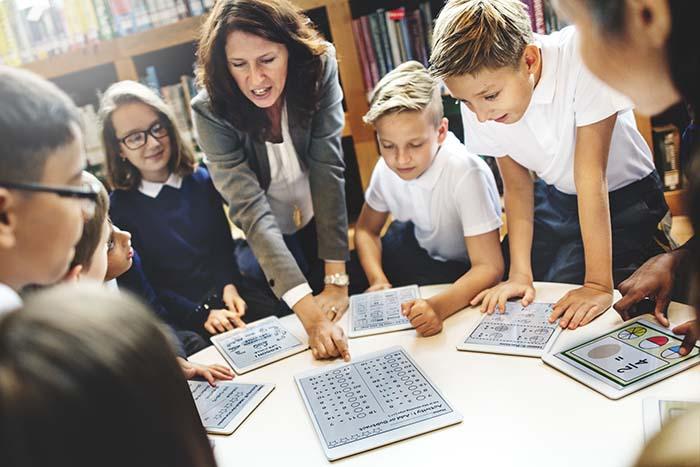 school teacher teaching students